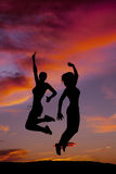 Tow Women Fitness Jumping Sunset Stock Photography