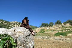 Tow women sitting on rock. Two girls sitting on a rock and looking at the summer landscape royalty free stock images