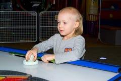 Towable play Air Hockey. Boy play at amusement Air hockey stock photography
