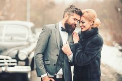 Toward adventure Happy loving couple is relaxing and enjoying road trip. Young woman, man and vintage car on winter. Toward adventure Happy loving couple is stock image