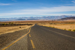 Toward the Mountains. A road leads into the countryside in the Leribe district of the mountainous South African country, Lesotho royalty free stock photo