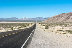 Towards Beatty from Death Valley, California, Nevada. View of the long route towards Beatty from Death Valley, California, Nevada Royalty Free Stock Photography