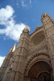 Towards a clouds. Towers of a cathedral in Palma de Majorca in Spain stock photo
