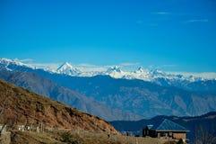 Towards Himalayas. A Lonely house near himalayan mountain range in Kashmir Royalty Free Stock Photos