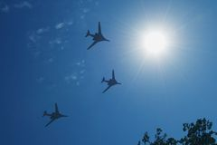 Towards the Sun. Three jet planes flying in the blue sky Royalty Free Stock Image