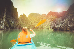 Towards to adventures in a kayak. In the picturesque Halong Bay Royalty Free Stock Image