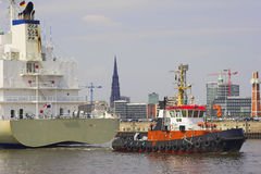 Towboat and freighter. In the harbour of hamburg Stock Photos