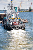 Towboat pushing a barge Stock Photo