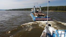 Towboat in River threshold. Towboat pushing  passenger ship upstream river stock video footage