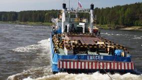 Towboat in River threshold. Towboat pushing  passenger ship upstream river stock footage