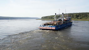 Towboat in River threshold. Towboat pushing  passenger ship upstream river stock video
