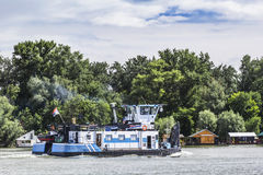 Towboat On Sava River - Belgrade - Serbia. Photograph of a new, white-blue towboat heading upstream on Sava river - Belgrade - Serbia Royalty Free Stock Images