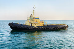 Towboat in sea port Stock Photography