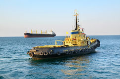 Towboat and ship Stock Images