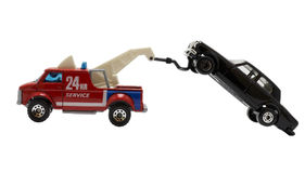 Towed away. A car being towed away by red tow truck Royalty Free Stock Photos