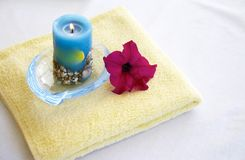 Towel. With flower and candel Stock Photos