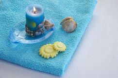Towel. With shells and candel Stock Images