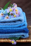 Towel. A pile of blue and blue-purple towel with flower Stock Image