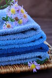 Towel. Pile of blue and blue-purple towel with flower Stock Photo