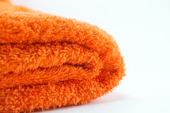 Towel. Orange towel on a white background Royalty Free Stock Images