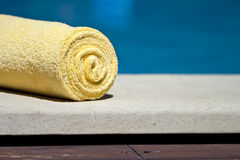 Towel. Roled towel by the pool Royalty Free Stock Photos