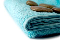 Towel. Stone for massage on turn blue towel stock photos