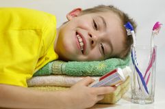 Towel. Child of eight years, who embraces soft towel Stock Image