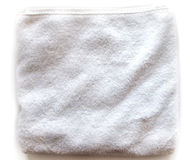 Towel. White rolled towel isolated on a neutral background Stock Photos