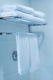 Towel. The towel hangs on a hanger in a bathroom Stock Photos