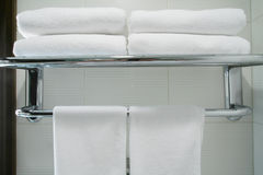 Towel. The towel hangs on a hanger in a bathroom Royalty Free Stock Photography