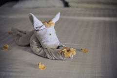 Towel animal on a hotel bed Royalty Free Stock Photos