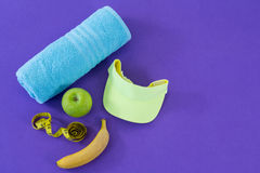 Towel, apple, towel, sun hat and measuring tape Royalty Free Stock Images
