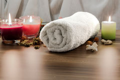 Towel, aromatic candles and other spa objects Royalty Free Stock Photos