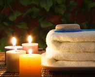 Towel, aromatic candles and other spa objects Royalty Free Stock Images