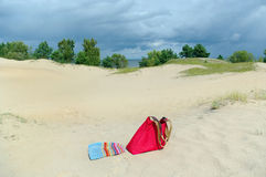 Towel and bag on a sand. Stock Photography