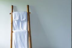 Towel on bamboo hanger. Towels hanging on the bamboo hanger and ready to use Royalty Free Stock Image