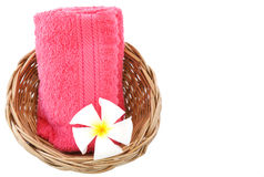 Towel in basket isolated white background. Towel in basket isolated on white background Royalty Free Stock Photography