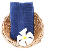 Towel in basket isolated white background. Towel in basket isolated on white background Stock Photo