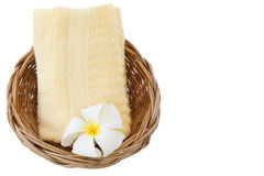 Towel in basket isolated white background. Towel in basket isolated on white background Royalty Free Stock Image