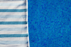 Towel and bathing accessories near pool Stock Images