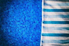Towel and bathing accessories near pool Royalty Free Stock Photography