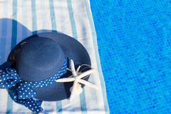 Towel and bathing accessories near pool Royalty Free Stock Images