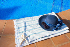 Towel and bathing accessories near pool Stock Photography