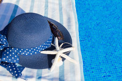 Towel and bathing accessories near pool Royalty Free Stock Image
