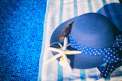 Towel and bathing accessories near pool Stock Photo