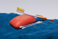 Towel with bathroom accessories Stock Photo
