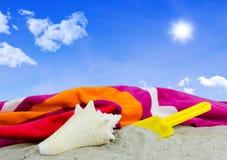 Towel on the beach Stock Photo