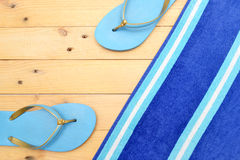 Towel and beach slippers Royalty Free Stock Photography