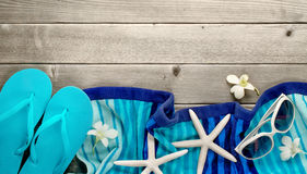 Towel and beach slippers on wood Royalty Free Stock Photo