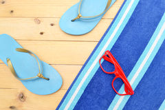 Towel and beach slippersBeach slippers, towel and sunglasses Stock Images